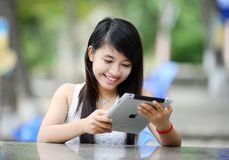 Woman using Apple tablet