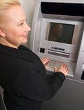 Woman using ATM Stock Photography