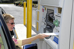 Woman using ATM Royalty Free Stock Photography