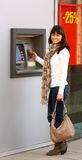 Woman using an ATM royalty free stock photography