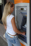 Woman using ATM Royalty Free Stock Photos