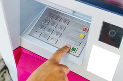 Woman using ATM machine Royalty Free Stock Images