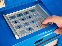 Woman using ATM machine to withdraw money. Woman press on ATM keyboard to entering PIN or pass code on ATM bank machine Royalty Free Stock Image