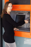 Woman using ATM Stock Image