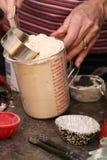 Woman using baking ingredients Royalty Free Stock Image