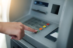 Woman using banking machine Royalty Free Stock Photography