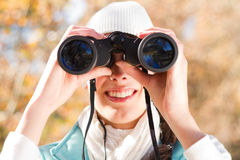 Woman using binoculars Royalty Free Stock Image