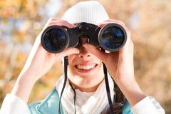 Woman using binoculars Royalty Free Stock Image