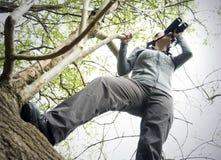 Woman using binoculars Stock Photo