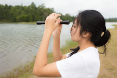 Woman using binoculars in the topical forest. Young asian woman using binoculars in the topical forest Stock Images
