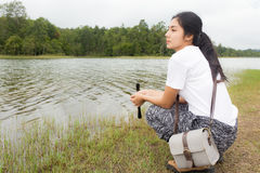 Woman using binoculars in the topical forest. Royalty Free Stock Photo