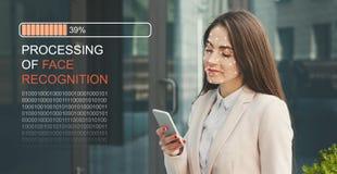 Woman using biometric facial verification on smartphone royalty free stock image