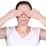 Woman using both hands to cover her eyes Royalty Free Stock Image