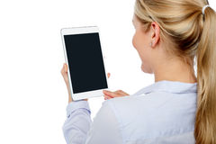 Woman using brand new tablet pc Stock Photography