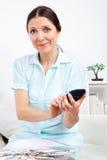 Woman using calculator Royalty Free Stock Image