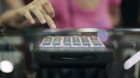 Woman using a calculator. Woman is using a calculator stock video footage