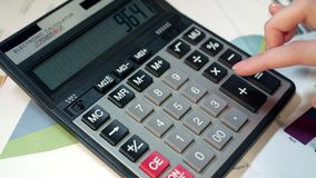 Woman using calculator. Business accounting and money calculation. Woman using calculator. Business accounting and money profit calculation. Close up of business stock footage
