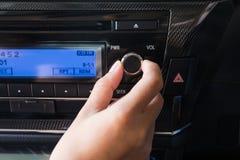 Woman using car volume audio royalty free stock photos