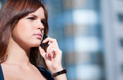 Woman using cell phone Royalty Free Stock Images