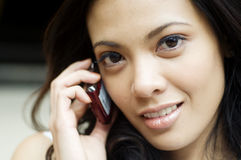 Woman using cell phone Royalty Free Stock Photography