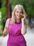 Woman Using Cell Phone in City Stock Images