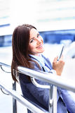 Woman using a cell phone Royalty Free Stock Images