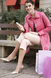 Woman Using Cell Phone Sitting on Bench Stock Photo
