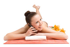 Woman using cell phone in spa Royalty Free Stock Photo