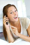 Woman using cellphone Stock Image