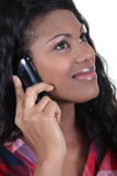Woman using a cellphone Stock Photography