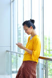 Woman Using Cellphone Royalty Free Stock Photography