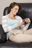 Woman using cellphone Stock Photography