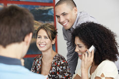 Free Woman Using Cellphone In Meeting By Colleagues Stock Photography - 33894952