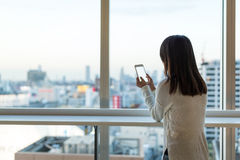 Woman using cellphone inside business building Stock Photography