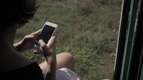 Woman using cellphone phone inside old asia train stock video footage