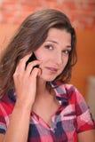 Woman using a cellphone Stock Photos