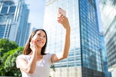Woman using cellphone for taking selfie. Asian young little boy stock photography
