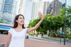 Woman using cellphone to take photo Royalty Free Stock Photo
