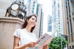 Woman using city map in Hong Kong Stock Image