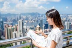 Woman using city map in Hong Kong Royalty Free Stock Images