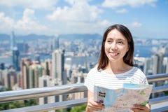 Woman using city map in Hong Kong Stock Photography