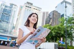 Woman using city map in Hong Kong Royalty Free Stock Photography