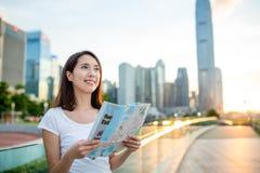 Woman using city map in Hong Kong city Royalty Free Stock Image