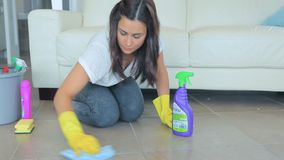 Woman using cleaner stock footage