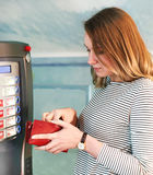 Woman using coffee machine. Royalty Free Stock Image