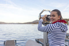 Woman using coin operated binoculars Royalty Free Stock Photography