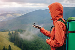 Woman using compass while hiking in mountain Royalty Free Stock Images