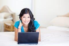 Woman using computer Stock Image