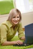 Woman using computer at home Stock Photo