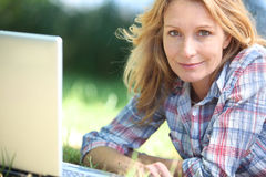 Woman using computer outdoors Royalty Free Stock Photos